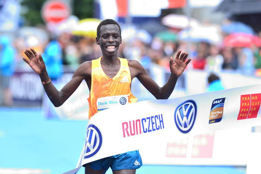 Patrick Terer of Kenya crosses the finish line to win the 20th Prague International Marathon in Prague, Czech Republic, on Sunday, May 11, 2014. (AP Photo/CTK, Vit Simanek) SLOVAKIA OUT