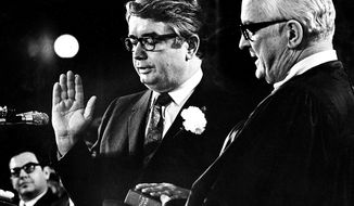 In this Jan. 4, 1971 photo, Patrick Lucey, center, is sworn in as Wisconsin Governor by Judge E. Harold Hallows, in Madison, Wis. Lucey, a hard-nosed Democratic politician who later became ambassador to Mexico, died Saturday, May 10, 2014. He was 96. (AP Photo/Wisconsin State Journal, Ed Stein)