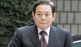 FILE - In this Oct. 10, 2008 file photo, Samsung Electronics Co. Chairman Lee Kun-hee arrives for his trial at the Seoul Court House in Seoul, South Korea. Lee was hospitalized in stable condition at a Seoul hospital Sunday, May 11, 2014, after suffering a heart attack, the company said in a statement. (AP Photo/ Lee Jin-man, File)