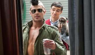 "This image released by Universal Pictures shows Zac Efron, left, and Dave Franco in a scene from the film, ""Neighbors."" (AP Photo/Universal Pictures, Glen Wilson)"