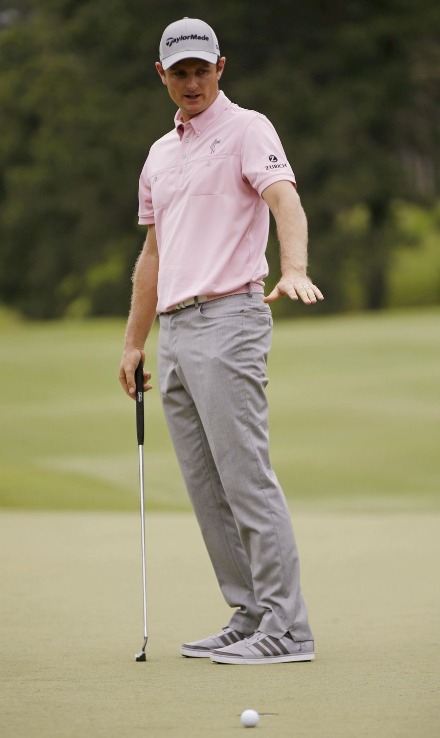 Justin Rose of England, gestures after his ball misses the 7th hole cup during the final round of The Players championship golf tournament at TPC Sawgrass, Sunday, May 11, 2014 in Ponte Vedra Beach, Fla. (AP Photo/Gerald Herbert)