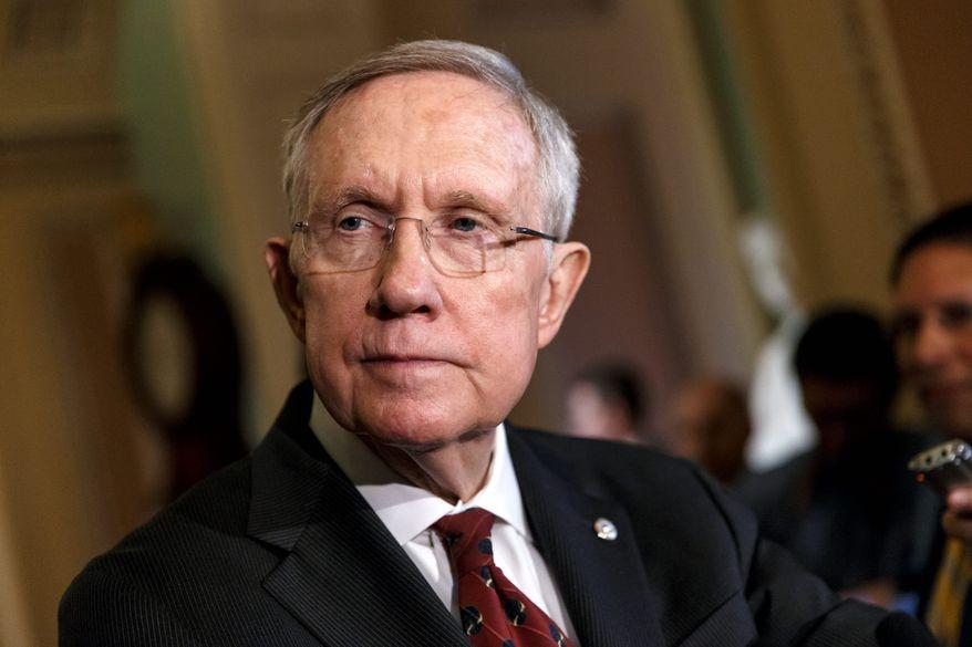 Senate Majority Leader Harry Reid, Nevada Democrat, has promised a vote on Keystone if the Senate moves forward on an energy efficiency bill. (Associated Press)
