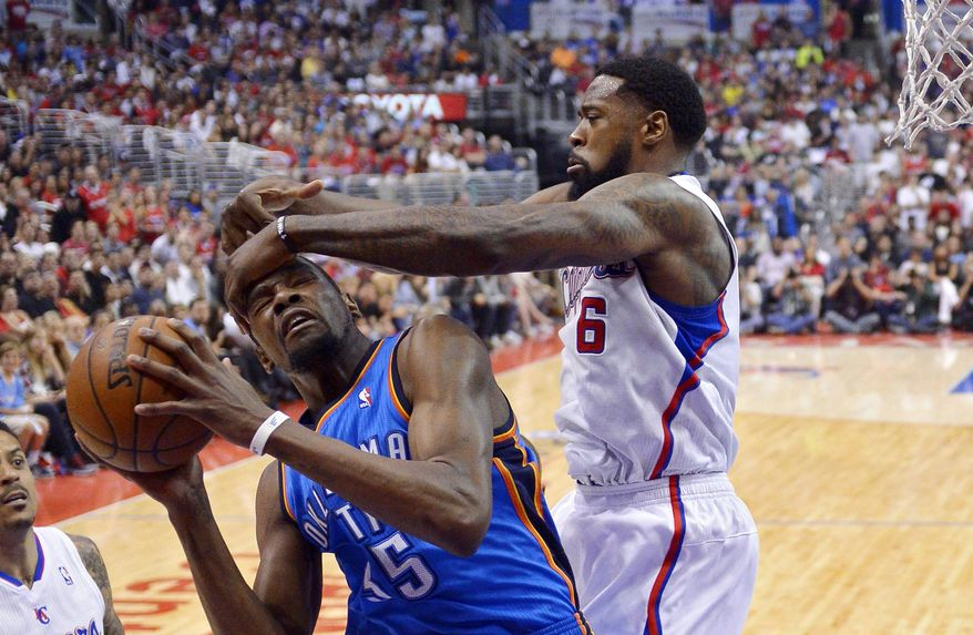 Los Angeles Clippers center DeAndre Jordan, right, smacks Oklahoma City Thunder forward Kevin Durant on the head as he goes up for a shot in the first half of Game 4 of the Western Conference semifinal NBA basketball playoff series, Sunday, May 11, 2014, in Los Angeles. (AP Photo/Mark J. Terrill)