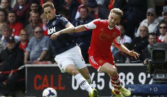 Southampton's Luke Shaw, right, competes for the ball with Manchester United's Adnan Januzaj during their English Premier League soccer match at St Mary's stadium, Southampton, England, Sunday, May 11, 2014. (AP Photo/Sang Tan)