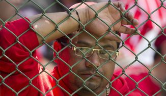 Toluca fan looks dejected after his team lost 2-0 to Leon, during a Mexican soccer league match in Toluca, Sunday, May 11, 2014. (AP Photo/Christian Palma)