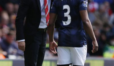 Manchester United's interim manager Ryan Giggs, left, instructs Patrice Evra during their English Premier League soccer match against Southampton at St Mary's stadium, Southampton, England, Sunday, May 11, 2014. (AP Photo/Sang Tan)
