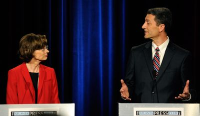 Democratic senatorial candidates Michelle Nunn, the former CEO of Points of Light from Atlanta, left, and Branko Radulovacki, a psychiatrist from Atlanta, participate in a debate at the Georgia Public Broadcasting studio, Sunday, May 11, 2014, in Atlanta. (AP Photo/David Tulis)