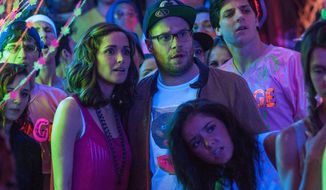 "This image released by Universal Pictures shows Rose Byrne, left, and Seth Rogen in a scene from the film, ""Neighbors."" (AP Photo/Universal Pictures, Glen Wilson)"