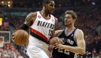 San Antonio Spurs' Tiago Splitter, right, guards Portland Trail Blazers' LaMarcus Aldridge (12) in the first quarter during Game 3 of a Western Conference semifinal NBA basketball playoff series Saturday, May 10, 2014, in Portland, Ore. (AP Photo/Rick Bowmer)