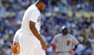 Los Angeles Dodgers relief pitcher Kenley Jansen walks back to the mound after San Francisco Giants' Hector Sanchez (not shown) hit a single to score a run in the tenth inning of a baseball game on Sunday, May 11, 2014, in Los Angeles. The Giants won 7-4 in 10 innings. (AP Photo/Alex Gallardo)