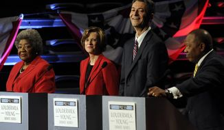 Democratic senatorial candidates, from left to right, Steen Miles, a former state lawmaker and broadcaster from Decatur, Ga., Michelle Nunn, the former CEO of Points of Light from Atlanta, Branko Radulovacki, a psychiatrist from Atlanta and Todd Anthony Robinson, an ROTC instructor from Columbus, Ga., participate in a debate at the Georgia Public Broadcasting studio, Sunday, May 11, 2014, in Atlanta. (AP Photo/David Tulis)