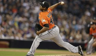 Miami Marlins relief pitcher Carlos Marmol throws against the San Diego Padres during the sixth inning of a baseball game Saturday, May 10, 2014, in San Diego. (AP Photo/Gregory Bull)