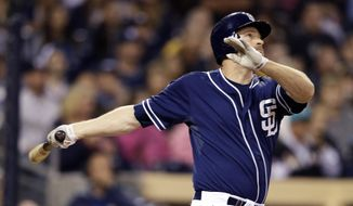 San Diego Padres' Chase Headley watches his three-run home run while playing the Miami Marlins during the sixth inning of a baseball game Saturday, May 10, 2014, in San Diego. (AP Photo/Gregory Bull)