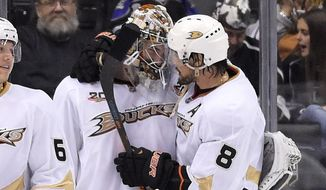 Anaheim Ducks right wing Teemu Selanne, of Finland, congratulates Anaheim Ducks goalie John Gibson after Game 4 of an NHL hockey second-round Stanley Cup playoff series, Saturday, May 10, 2014, in Los Angeles. The Duck won 2-0. (AP Photo/Mark J. Terrill)
