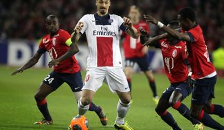 PSG's Zlatan Ibrahimovic, center, controls the ball during his French League one soccer match against Lille at the Lille Metropole stadium, in Villeneuve d'Ascq, northern France, Saturday, May 10, 2014. PSG has already won its second straight French league title. (AP Photo/Michel Spingler)