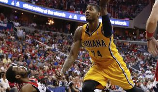 Indiana Pacers forward Paul George (24) collides with Washington Wizards guard John Wall, left, during the second half of Game 4 of an Eastern Conference semifinal NBA basketball playoff game in Washington, Sunday, May 11, 2014. (AP Photo/Alex Brandon)
