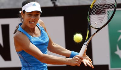 Serbia's Ana Ivanovic returns the ball to Italy Karin Knapp at the Italian open tennis tournament in Rome, Monday, May 12, 2014. (AP Photo/Riccardo De Luca)