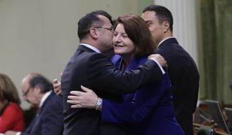 Assemblywoman Toni Atkins, D-San Diego, is hugged by Assemblyman V. Manuel Perez, D-Coachella, before she is sworn-in as Assembly Speaker at the Capitol in  Sacramento, Calif., Monday, May 12, 2014. Atkins is replacing Assembly Speaker John Perez who is termed out. (AP Photo)
