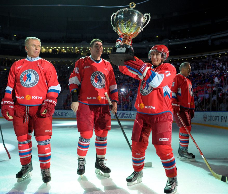 Russian President Vladimir Putin scored six goals and dished five assists Saturday to help his team win a hockey match Saturday. With him on the ice at a Sochi arena are Russian hockey stars. (Associated Press photographs)