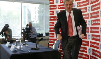 England's soccer manager Roy Hodgson leaves, after announcing the squad for the World Cup in Brazil at Vauxhall headquarters,  in Luton, England, Monday, May 12, 2014.  England coach Roy Hodgson selected a World Cup squad containing several young players on Monday, although Frank Lampard was among the veterans to still make the cut. (AP Photo/Sang Tan)