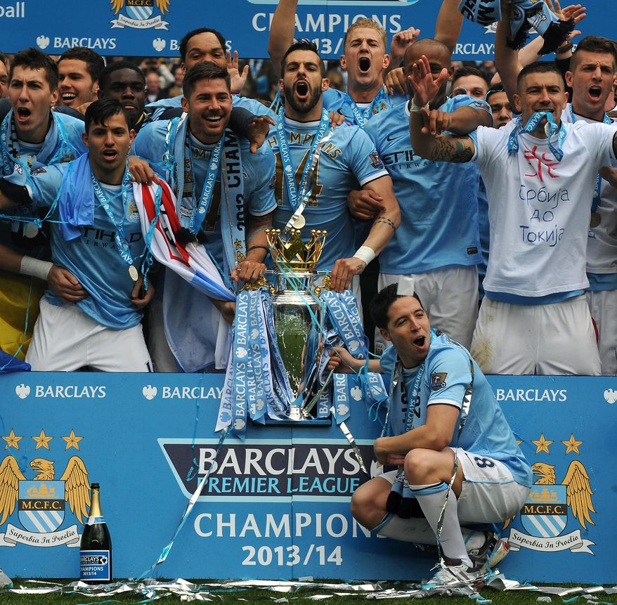 Manchester City's players celebrate after being crowned Champions after the English Premier League soccer match between Manchester City and West Ham United at the Etihad Stadium,  Manchester, England, Sunday, May 11, 2014. (AP Photo/Rui Vieira)