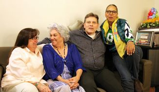 "This April 24, 2014 photo shows, from left, hair and makeup artist Geordie Sheffer, actress Tyne Daly, personal assistant John V. Fahey and dresser Valerie Gladstone in the dressing room at the Golden Theatre in New York. Daly is reuniting with her team from ""Gypsy"" on Broadway for the current run of ""Mothers and Sons."" (AP Photo/Mark Kennedy)"