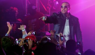 "FILE - In this June 23, 2010, file photo, Timbaland performs at a graduation party for students at Culver City High School in Culver City, Calif. Pepsi is pairing singers and filmmakers to release a visual album that celebrates soccer during World Cup. Spike Lee, Timbaland, Idris Elba and Kelly Rowland are some of the artists whose work is featured on the Pepsi-curated album, ""Beats of the Beautiful Game,"" to be released June 10, 2014. The soda company announced Monday, May 12 its album will be a collection of 11 anthem-like songs and short films. (AP Photo/Kristian Dowling, File)"