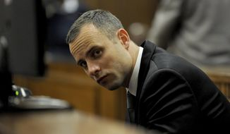 Oscar Pistorius sits in court for his ongoing murder trial in Pretoria, South Africa, Monday, May 12, 2014. Pistorius is charged with the shooting death of his girlfriend Reeva Steenkamp on Valentine's Day in 2013. (AP Photo/Chris Collingridge, Pool)