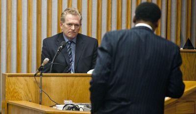 Film Midnight Rider Director Randall Miller, left, takes the witness stand during a hearing before Chatham County Superior Court, Judge John Morse, Monday, May 12, 2014, in Savannah, Ga. Singer Gregg Allman has filed a lawsuit to stop movie producers from reviving a film, titled Midnight Rider, based on his life story after a freight train plowed into crew members shooting on train tracks in southeast Georgia, killing one worker and injuring six others. (AP Photo/Stephen B. Morton)