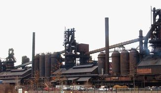 FILE -- In this March 21, 2005 file photo, the Severstal steel plant in Dearborn, Mich., is shown. Permits have been updated for the Detroit-area steelmaker and an oil refinery, the state Department of Environmental Quality announced Monday, May 12, 2014. A 2014 permit for Dearborn-based Severstal expands testing requirements, adds emission limits for fine particulates, enhances emission and operational monitoring requirements and provides the DEQ with more tools to make sure the steelmaker continues to comply. (AP Photo/Carlos Osorio)