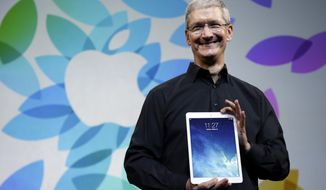 ** FILE ** In this Oct. 22, 2013, file photo, Apple CEO Tim Cook introduces the new iPad Air in San Francisco. (AP Photo/Marcio Jose Sanchez, File)