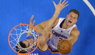 Los Angeles Clippers forward Blake Griffin, right, shoots as Oklahoma City Thunder center Steven Adams, of New Zealand, defends in the second half of Game 4 of the Western Conference semifinal NBA basketball playoff series on Sunday, May 11, 2014, in Los Angeles. The Clippers won 101-99. (AP Photo/Mark J. Terrill)
