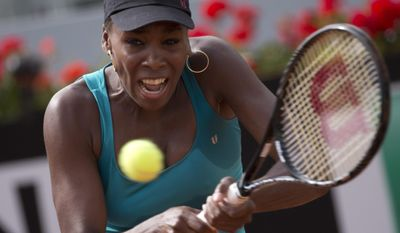 Venus Williams of the United States returns the ball to Annika Beck of Germany at the Italian Open tennis tournament, in Rome, Monday, May 12, 2014. (AP Photo/Alessandra Tarantino)