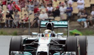 Mercedes driver Lewis Hamilton of Britain steers his car during the Spain Formula One Grand Prix at the Barcelona Catalunya racetrack in Montmelo, near Barcelona, Spain, Sunday, May 11, 2014. (AP Photo/Manu Fernandez)