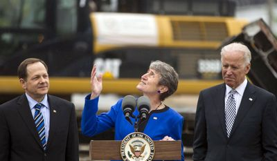 Secretary of the Interior Sally Jewell, center, speaks as Vice President Joe Biden, right, and St. Louis Mayor Francis Slay listen during a visit to the CityArchRiver project at the Gateway Arch on Tuesday, May 13, 2014, in St. Louis. (AP Photo/Whitney Curtis)