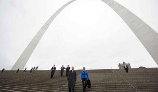 Vice President Joe Biden, left, and Secretary of the Interior Sally Jewell take a tour of the CityArchRiver project at the Gateway Arch on Tuesday, May 13, 2014, in St. Louis. Following them are Sen. Michael Bennet (D-Colo.), from left to right, Sen. Dick Durbin (D-Ill.) and St. Louis Mayor Francis Slay. (AP Photo/Whitney Curtis)