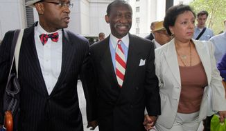 """FILE - In this July 26, 2012, file photo, attorney Anthony Ricco, left, walks with Larry Seabrook, center, a New York City councilman and Seabrook's wife Maria Diaz, as they leave Federal Court in New York during Seabrook's corruption trial. It can be an uncomfortable life for any defense attorney representing unpopular clients, but when Ricco was among a handful of respected defense lawyers summoned to the federal courthouse in Manhattan after Sept. 11, he recalled his mother telling him, in a moment of outrage, """"If you go down there to represent them, I will never speak to you again."""" (AP Photo/Richard Drew, File)"""