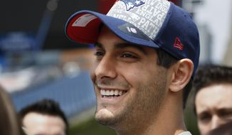 New England Patriots NFL rookie football quarterback Jimmy Garoppolo speaks with members of the media on the field at Gillette Stadium, in Foxborough, Mass., Tuesday, May 13, 2014. (AP Photo/Steven Senne)