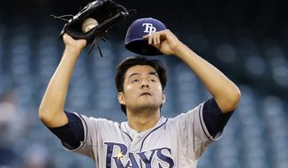 Tampa Bay Rays starting pitcher Cesar Ramos takes a breather after throwing a pitch against the Seattle Mariners in the second inning of a baseball game Monday, May 12, 2014, in Seattle. Ramos gave up five runs in the second inning. (AP Photo)