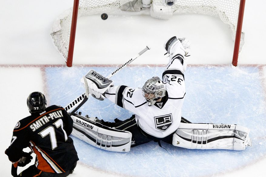 Anaheim Ducks right wing Devante Smith-Pelly, left, scores past Los Angeles Kings goalie Jonathan Quick during the second period in Game 5 of an NHL hockey second-round Stanley Cup playoff series in Anaheim, Calif., Monday, May 12, 2014. (AP Photo/Chris Carlson)