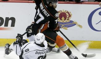 Anaheim Ducks right wing Devante Smith-Pelly, top, knocks Los Angeles Kings defenseman Drew Doughty off the puck during the third period in Game 5 of an NHL hockey second-round Stanley Cup playoff series in Anaheim, Calif., Monday, May 12, 2014. (AP Photo/Chris Carlson)
