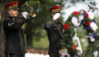 """An Army honor guard bugler plays """"Taps"""" after a wreath was laid at the gravesite of Army Pvt. William Christman, who was the first military burial at the cemetery, marking the beginning of commemorations of the 150th anniversary of Arlington National Cemetery in Arlington, Va., Tuesday, May 13, 2014. Christman, 20, enlisted in the 67th Pennsylvania Infantry and was hospitalized for measles five weeks later, dying on May 11, 1864 and buried at Arlington on May 13. (AP Photo)"""