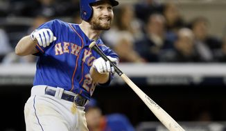 New York Mets Daniel Murphy watches the path of his fifth-inning, three-run, home run off New York Yankees relief pitcher Alfredo Aceves in a baseball game at Yankee Stadium in New York, Tuesday, May 13, 2014. (AP Photo)
