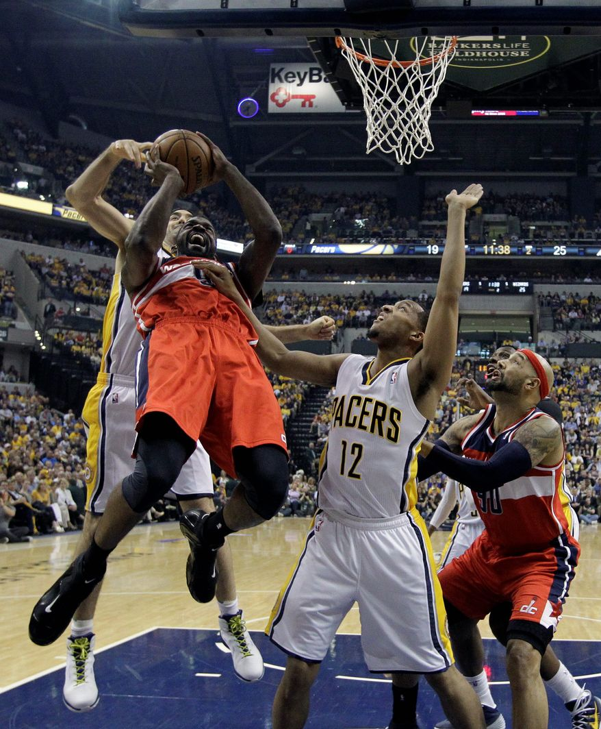 Washington's Martell Webster puts up a shot in traffic Tuesday during the first half of the Wizards' 102-79 Game 5 victory over the Pacers in Indianapolis. (associated press)