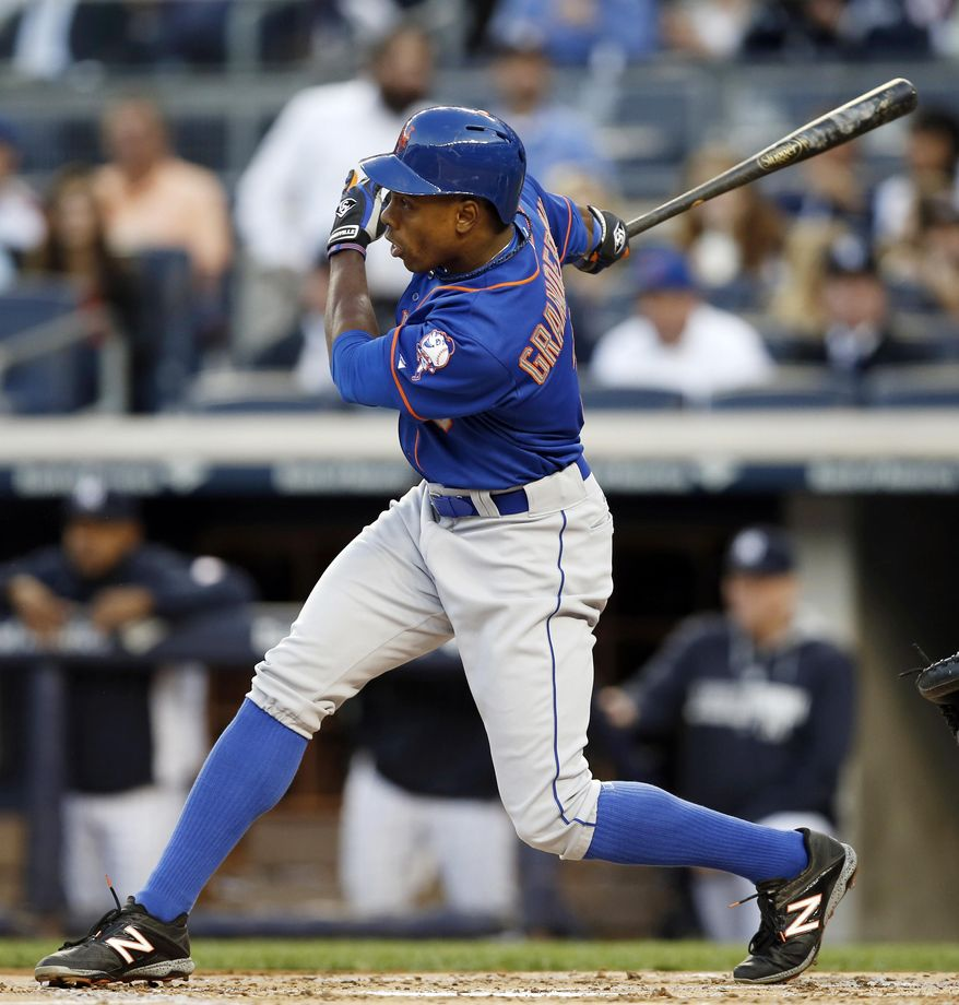 New York Mets Curtis Granderson hits a first-inning, three-run home run in a baseball game against the New York Yankees at Yankee Stadium in New York, Tuesday, May 13, 2014. (AP Photo)