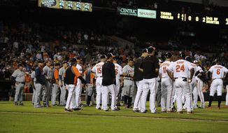 The Benches clear and come onto the field after Detroit Tigers' Torii Hunter was hit by a pitch by Baltimore Orioles starting pitcher Bud Norris during the eighth inning of a baseball game, Monday, May 12, 2014, in Baltimore. The Tigers won 4-1. (AP Photo/Nick Wass)