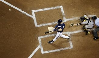 Milwaukee Brewers' Jonathan Lucroy hits a two-run scoring double during the third inning of a baseball game against the Pittsburgh Pirates, Tuesday, May 13, 2014, in Milwaukee. (AP Photo/Morry Gash)