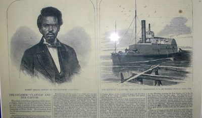 FILE - This May 2, 2012 file photo shows a display at the Charleston Museum in Charleston, S.C., of an 1862 Harpers Weekly article about Robert  Smalls and the CSS Planter. Researchers announced on Tuesday, May 13, 2014 that they believe they have found the wreck of the Planter on the South Carolina coast. Smalls commandeered the Confederate vessel in 1862 and turned it over to the Union navy. (AP Photo/Bruce Smith, file)