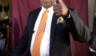 Newark mayoral candidate Ras Baraka gives a thumbs-up after casting his vote, Tuesday, May 13, 2014, in Newark, N.J. The election will decide whether Shavar Jeffries, a former state assistant attorney general, or Baraka, a city councilman, will take over the seat Cory Booker occupied from 2006 until October 2013, when he won a special election to succeed U.S. Sen. Frank Lautenberg, who died in office. (AP Photo)