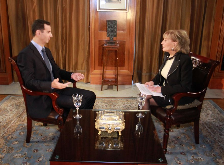 """FILE - In this undated file image provided by ABC, Syrian President Bashar Al-Assad speaks with ABC News Anchor Barbara Walters for an interview that aired on Dec. 7, 2011, on ABC. On Friday, May 16, 2014, capping a spectacular half-century run she began as the so-called """"Today"""" Girl, Walters will exit ABC's """"The View."""" Behind the scenes she will remain as an executive producer of the New York-based talk show she created 17 years ago, and make ABC News appearances as events warrant and stories catch her interest. (AP Photo/ABC, Rob Wallace, File)"""